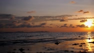 Stock Video Footage of Happy Family Couple on Beach at Sea Sunset on Vacation