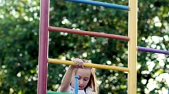 Girl climbing the metal stairs, playground Stock Footage
