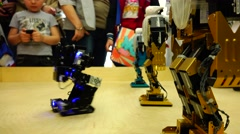 New technologies. Robot. AI. Children playing with robots. Stock Footage