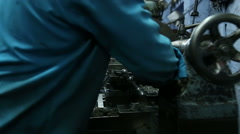 Indian man moving parts of machine in workshop in Jodhpur. Stock Footage