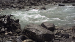 Rocky water rapids river, medium shot, shallow DOF - stock footage