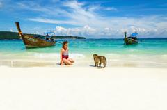Longtail boat, monkeys waiting for food, Thailand Stock Photos