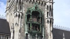 ULTRA HD 4K Closeup Glockenspiel figures statue clock tower Munich landmark day  Stock Footage