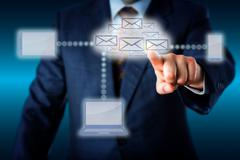 Manager Touching A Host Of Emails In Cloud Network Stock Photos
