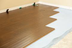 Newly Installed Brown Laminate Flooring Abstract. Stock Photos