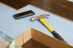Hammer and Block with New Laminate Flooring Abstract. - stock photo