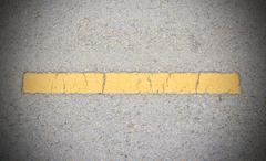 Road asphalt texture and yellow line Stock Photos