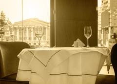 Black and white sepia tonned photo of a restaurant table Stock Photos