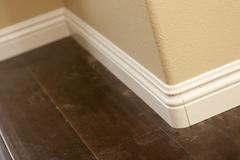 New Baseboard and Bull Nose Corners with Laminate Flooring Abstract. - stock photo
