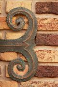 brown brick wall with shod decor - stock photo