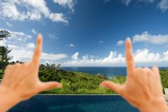 Hands Framing Breathtaking Hawaiian Ocean View Deck and Pool with Deep Blue S - stock photo