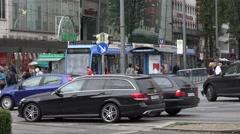 ULTRA HD 4K Busy traffic street crowded downtown Munich tramway station commuter Stock Footage