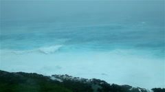 Cyclone driven waves crash against rocky shoreline - stock footage