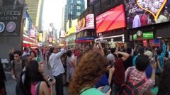Tourists taking picture of the billboard in Times Square Stock Footage