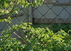 fence of metal wire - stock photo