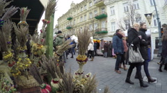 Palm decorations and people in spring event market fair Stock Footage