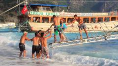 Boat trip passengers rescued by crew after becoming stranded by waves Stock Footage