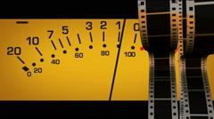 Scrolling filmstrips on volume meter Stock Footage