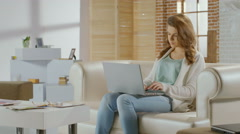 Young woman sitting in room with laptop, bad news, breakup Stock Footage