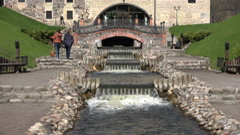 Girls walk near flowing river brook waterfall water stairs. 4K Stock Footage