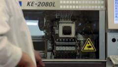 Detail view of Automated machine at work in factory - stock footage