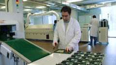 Worker producing PCB boards Stock Footage