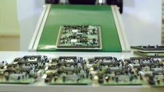 Factory assembly line production of PCBs for electronic equipment. - stock footage