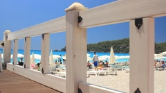 Summer and vacation concept with a beach view behind wooden fence at Oludeniz Stock Footage