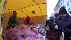 Vendors sell baked bagel homemade black bread on city fair. 4K Stock Footage