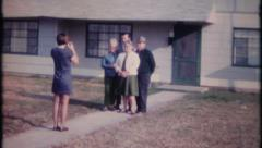 Stock Video Footage of 2111 - woman takes photo & hugs relatives goodbye - vintage film home movie