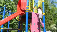 Asian Girl Climbing Playground Structure And Using Slide Stock Footage