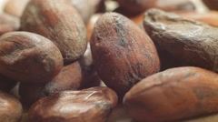 Stock Video Footage of Large plans of raw cacao beans. Healthy eating lifestyle. Macro shot.