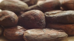 Stock Video Footage of raw cacao beans. Healthy eating lifestyle. Macro shot.