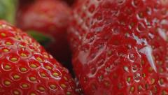 A drop of water falls on fresh, ripe, juicy, delicious strawberries. Macro shot. Stock Footage