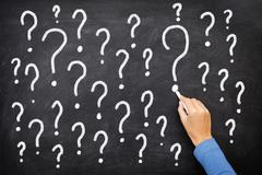 Question mark on  blackboard sign - stock photo
