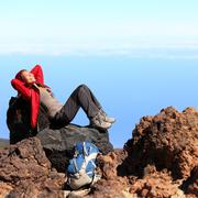 Resting relaxing hiker during hiking travel Stock Photos