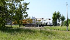 Transportation of yellow building crane on truck in a city Stock Footage