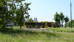 Yellow bus passing by quickly in a city Stock Footage