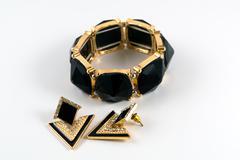 Plastic bracelet and earrings Stock Photos