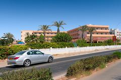 Car moving near Cyprus hotels Stock Photos