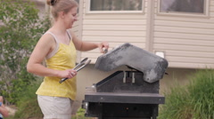 Girl grilling outside Stock Footage