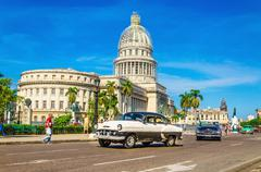 Stock Photo of Classic American car in front of Capitol, Havana