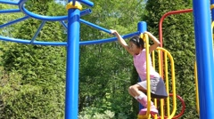 Asian Girl Climbing On Monkey Bars At Playground Stock Footage