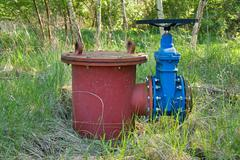 Old expansion pipe of drink water pipes joined with new blue valve and new bl Stock Photos