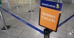 Singapore Airlines Internet check-in sign - stock footage