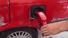 Petrol nozzle refilling up gasoline tank Stock Footage