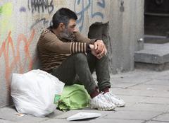Homeless desperate beggar begging - stock photo