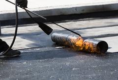 Stock Photo of Highway workers waterproof bridge Welding Torch fire