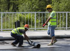 Stock Photo of Highway workers waterproof bridge