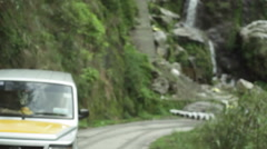 Jeep driving dangerous mountain road, shallow DOF Stock Footage